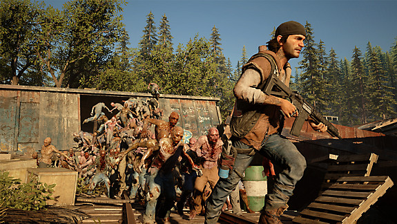 Days Gone screenshot - Deacon running from a freaker horde