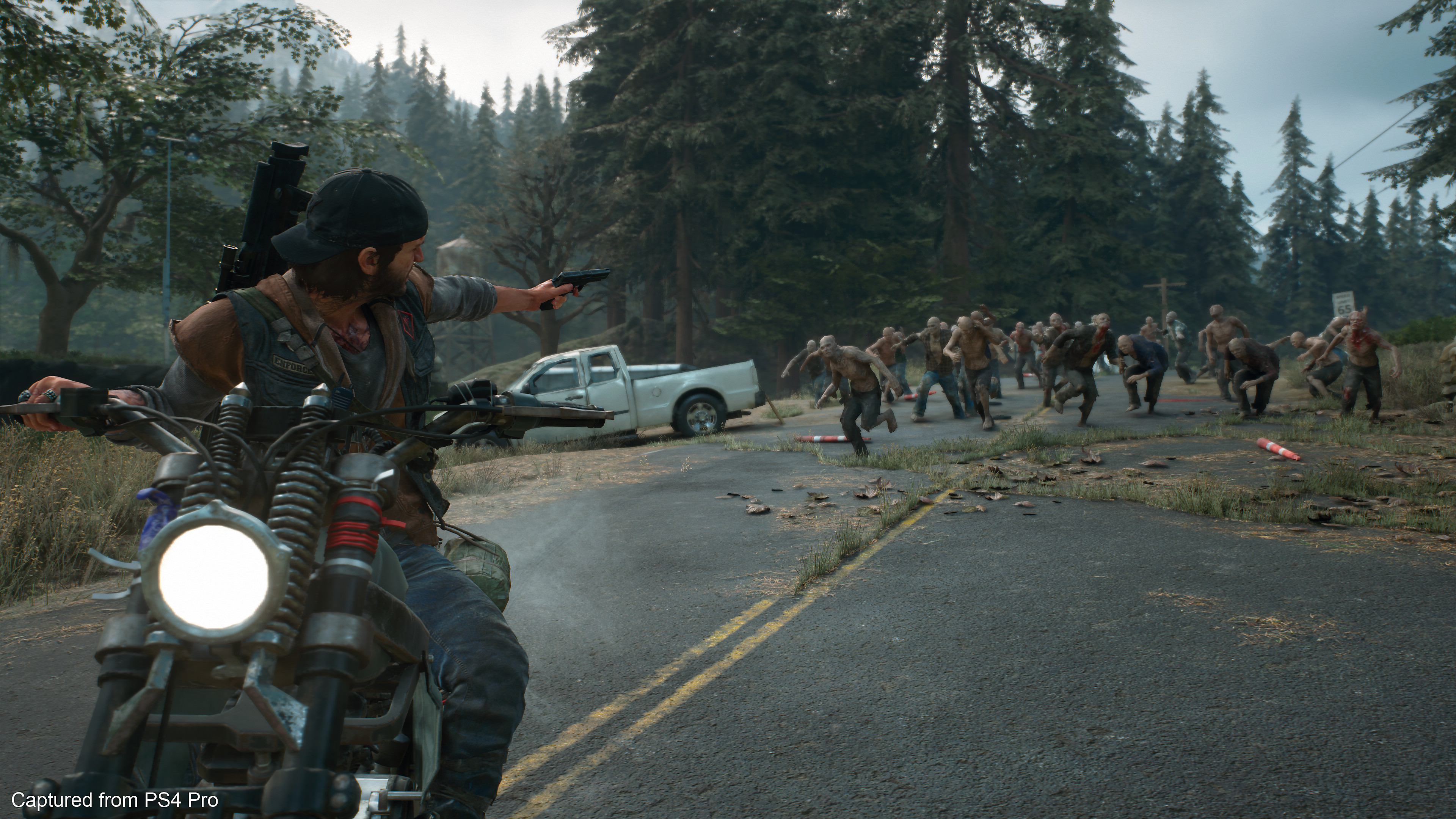 Days Gone Screenshot - Deacon shooting freakers on his bike