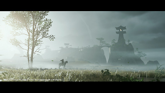 A fortress on a grassy field, with fog rolling over, and a man sitting on his horse.