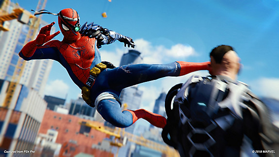 Spider-Man delivering a kick to an enemy
