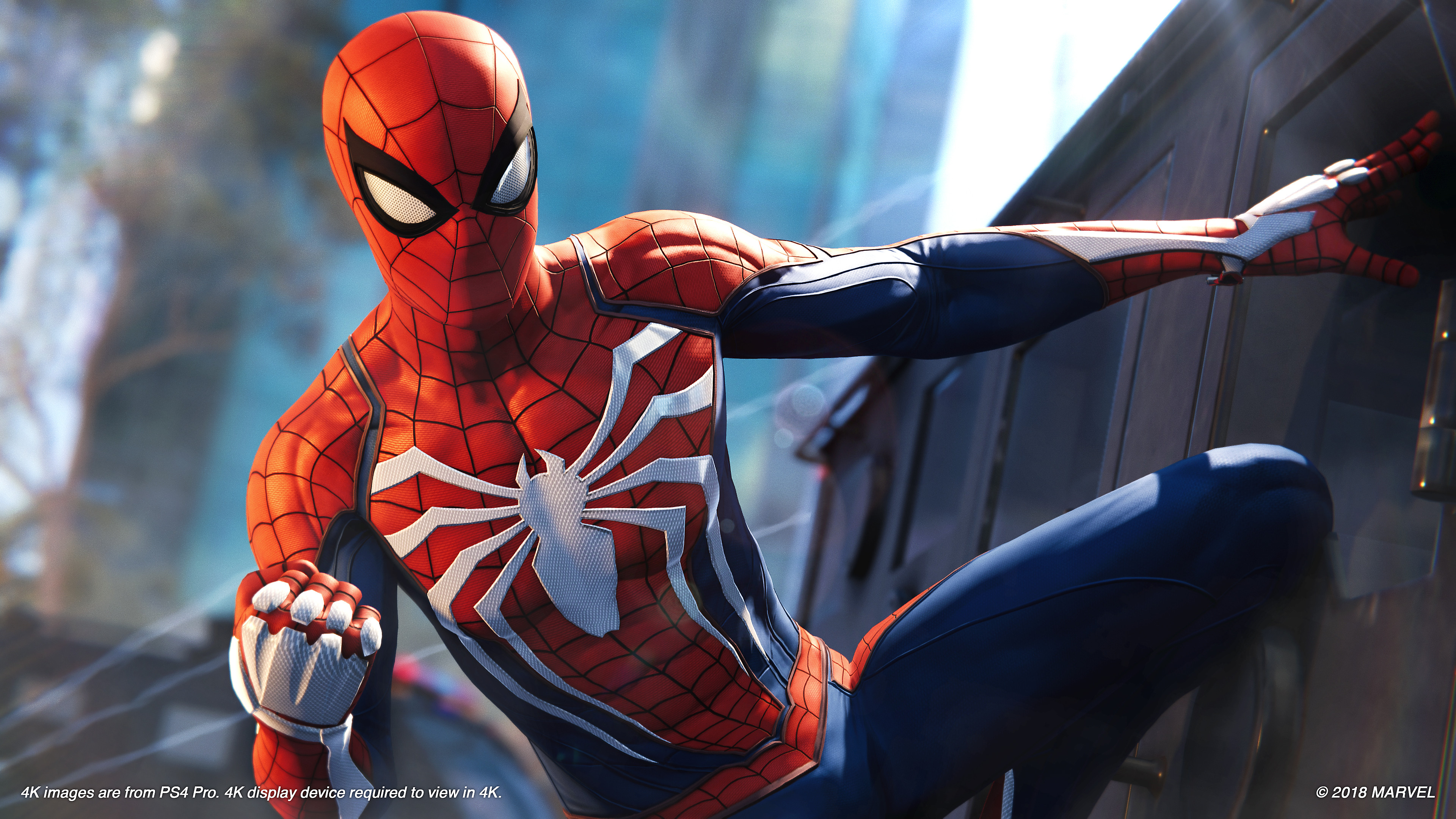 Marvel's Spider-Man Screenshot - Spider-Man hanging from the side of a building, ready for action